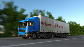 Freight semi truck with Johnson`s logo driving along forest road, seamless loop. Editorial 4K clip. Freight semi truck with Johnson`s logo driving along forest stock video footage
