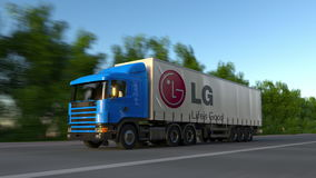 Freight semi truck with LG Corporation logo driving along forest road, seamless loop. Editorial 4K clip. Freight semi truck with LG Corporation logo driving stock video