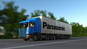Freight semi truck with Panasonic Corporation logo driving along forest road, seamless loop. Editorial 4K clip. Freight semi truck with Panasonic Corporation stock video