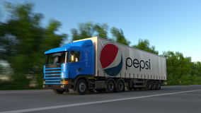 Freight semi truck with Pepsi logo driving along forest road, seamless loop. Editorial 4K clip. Freight semi truck with Pepsi logo driving along forest road stock video footage