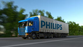 Freight semi truck with Philips logo driving along forest road, seamless loop. Editorial 4K clip. Freight semi truck with Philips logo driving along forest road stock video