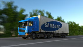 Freight semi truck with Samsung logo driving along forest road, seamless loop. Editorial 4K clip. Freight semi truck with Samsung logo driving along forest road stock video