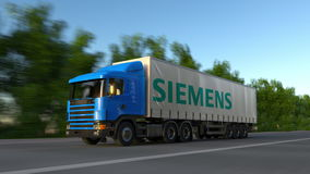 Freight semi truck with Siemens logo driving along forest road, seamless loop. Editorial 4K clip. Freight semi truck with Siemens logo driving along forest road stock footage