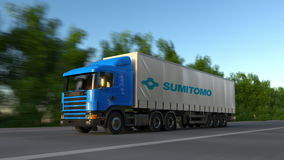 Freight semi truck with Sumitomo Corporation logo driving along forest road, seamless loop. Editorial 4K clip. Freight semi truck with Sumitomo Corporation logo stock footage
