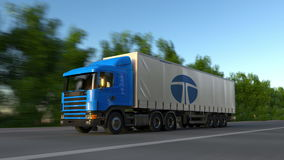 Freight semi truck with Tata Group logo driving along forest road, seamless loop. Editorial 4K clip. Freight semi truck with Tata Group logo driving along forest stock video footage