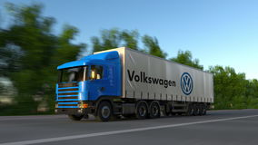 Freight semi truck with Volkswagen logo driving along forest road, seamless loop. Editorial 4K clip. Freight semi truck with Volkswagen logo driving along forest stock video footage