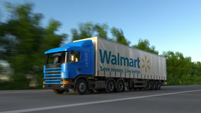 Freight semi truck with Walmart logo driving along forest road, seamless loop. Editorial 4K clip. Freight semi truck with Walmart logo driving along forest road stock footage