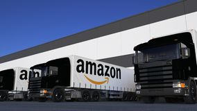 Freight semi trucks with Amazon.com logo loading or unloading at warehouse dock, seamless loop. Editorial animation