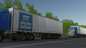 Freight semi trucks with China State Construction Engineering Corporation logo driving along forest road. Editorial 3D Royalty Free Stock Photos
