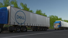 Freight semi trucks with Dell Inc. logo driving along forest road. Editorial 3D rendering Royalty Free Stock Images