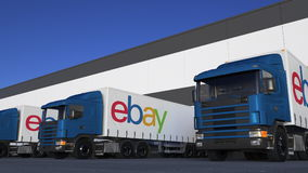 Freight semi trucks with eBay Inc. logo loading or unloading at warehouse dock. Editorial 3D rendering. Freight semi trucks with eBay Inc. logo loading or vector illustration