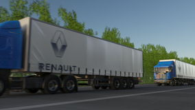 Freight semi trucks with Groupe Renault logo driving along forest road. Editorial 3D rendering Stock Photo