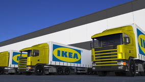 Freight semi trucks with Ikea logo loading or unloading at warehouse dock. Editorial 3D rendering. Freight semi trucks with Ikea logo loading or unloading at stock illustration