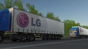 Freight semi trucks with LG Corporation logo driving along forest road. Editorial 3D rendering. Freight semi trucks with LG Corporation logo driving along forest Royalty Free Stock Image