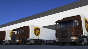 Freight semi trucks with United Parcel Service UPS logo loading or unloading at warehouse dock. Editorial 3D rendering. Freight semi trucks with United Parcel royalty free illustration