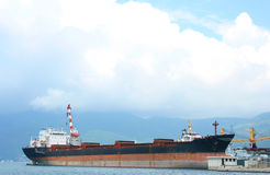 Freight ship. Large container ship in a dock of Tivat waithing to be repaired Stock Photos