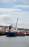 Freight Ship departing stock images