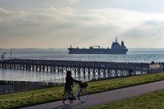 Freight ship entering Port of Vlissingem against backlight Royalty Free Stock Photography
