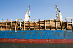 Freight Ship loaded with Logs Royalty Free Stock Photography