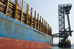 Freight Ship loaded with Logs Stock Photos