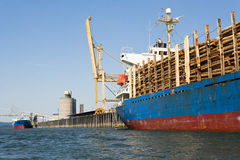 Freight Ship loaded with Logs Stock Photography