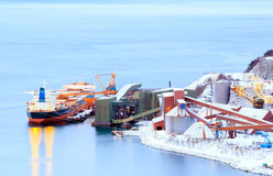 Freight ship at mine factory Stock Photo