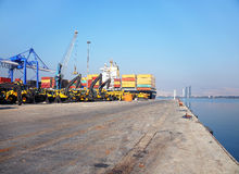 Freight ship moored in harbour Stock Photos