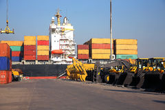 Freight ship moored in harbour Stock Images