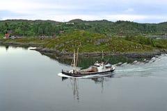 Freight ship before the norwegian coast Stock Photo