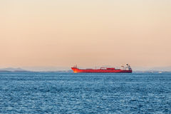 Freight ship on the ocean Stock Images
