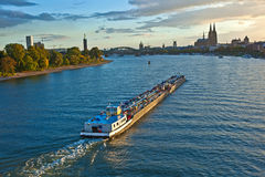 Freight ship on river Rhein by Cologne Royalty Free Stock Image