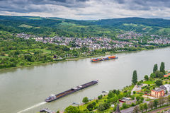 Freight ships on Rhine River, Germany, Brey and Rhens in backgro Royalty Free Stock Photos
