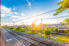 Freight Station with trains at sunrise, Blue sky Stock Photos