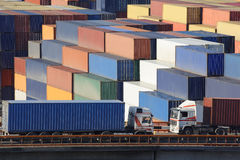Freight traffics car. Cargo car transporting container on background of the big terminal Royalty Free Stock Image