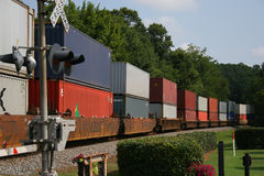 Freight Train. Across railroad crossing Stock Photos