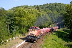 Freight train. Transporting bricks at the Mocseny Tunnel (Hungary). Type M40 locomotive is very rare Royalty Free Stock Photo