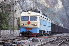 Freight train. In mountain area, A freight train moving on railway line Stock Photography