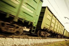 Freight train. Special toned and blur-motion photo f/x, focus point on railroad embankment and rail stock photos