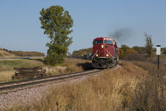 Freight Train. A freight train with a pair of red locomotives during autumn Stock Photography