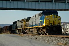 Freight Train. Under a bridge waiting for clearance to proceed onto the main track Stock Image