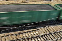 Freight Train. High perspective closeup of a moving freight train and tracks.  Motion blur Royalty Free Stock Photo