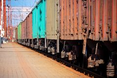 Freight train. Passing railway station royalty free stock images