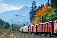 Freight train in autumn landscape Stock Photos
