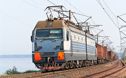 Freight train on a bank of the Dnieper Stock Image