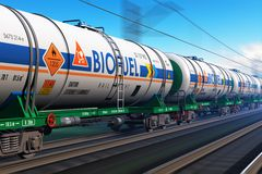 Freight train with biofuel tankcars. Creative abstract fuel, oil and gas industry, ecology protection technology, logistics, cargo shipping and freight railroad Stock Images