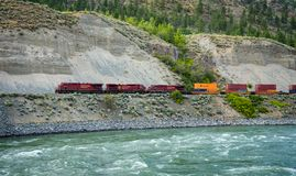 Freight train of Canadian Pacific Railway moving along the Thompson River royalty free stock photos