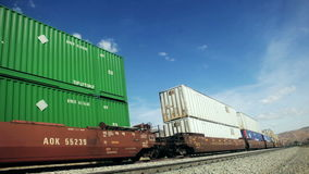 Freight train. Cargo boxes on a freight train - double stack stock video