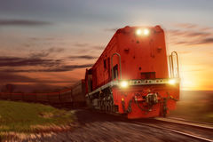 Freight train with cargo cars carrying coal Stock Images