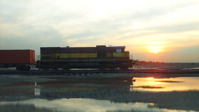 Freight train with cargo containers. Against Sunrise. 3d rendering. Royalty Free Stock Photography