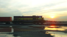 Freight train with cargo containers. Against Sunrise. logistic concept. Realistic cinematic 4k. stock video footage